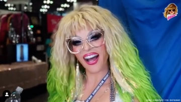 Willam, of RuPaul's Drag Race, in drag wearing a green wig.