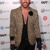 Joshua McKinley Cook from Project Runway on the Out100 red carpet