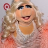 Miss Piggy walks the red carpet at the Out100 party