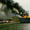 """Shelley Seccombe """"Fire on Pier 46 (Black Smoke and WTC),"""" 1980."""