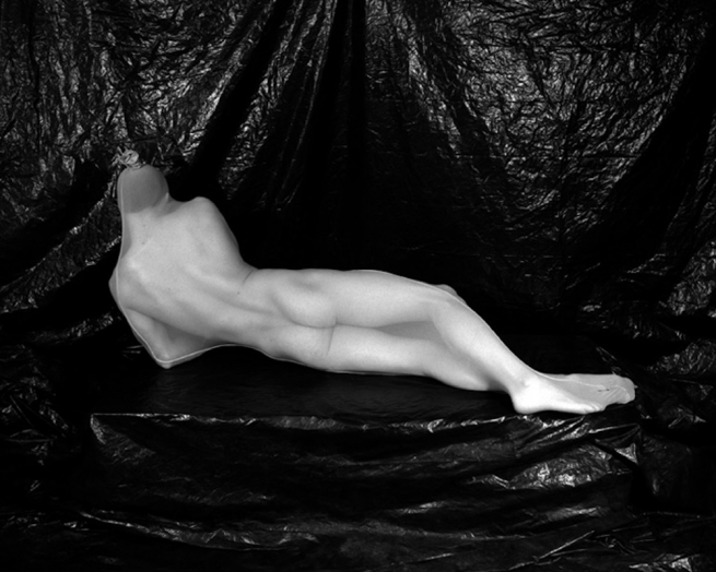 A figure nude, in a bodystocking.