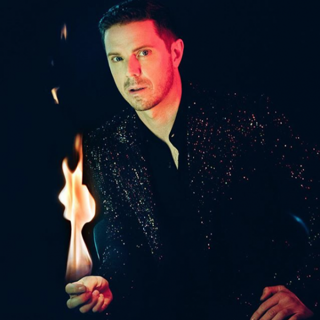 Jake Shears with fire.